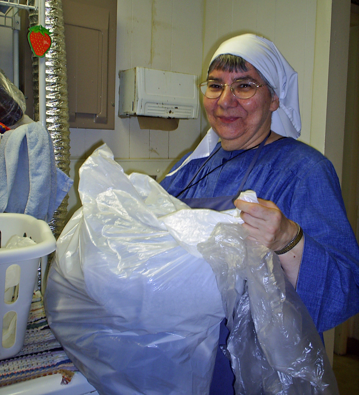 Sr. Joan (as a novice) washing the clothes of homeless men and women in the Hospitality Room of the Joseph House Crisis Center.