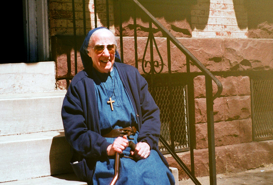 Sr. Mary Elizabeth on the steps of 2009 McCulloh Street during a visit to the old neighborhood. Photo taken in 1999.